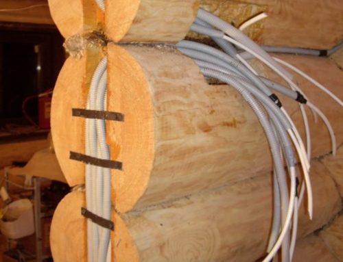 Электропроводка в бревенчатом доме и особенности ее монтажа